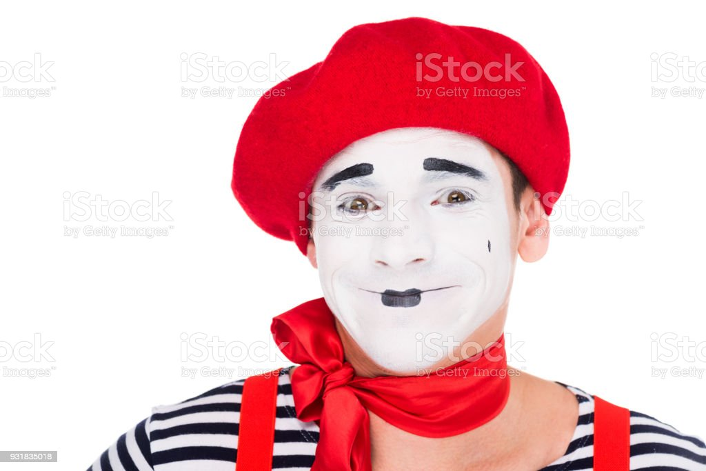 portrait of smiling mime looking at camera isolated on white stock photo