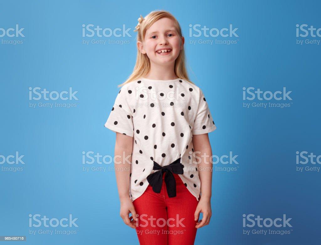 Portrait of smiling modern child in red pants on blue zbiór zdjęć royalty-free