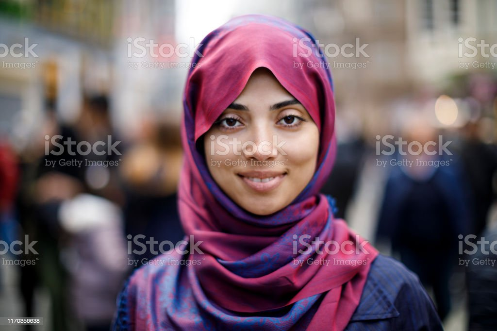 Portrait of smiling muslim woman outdoors Portrait of smiling muslim woman outdoors Adult Stock Photo