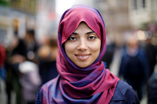 Portrait of smiling muslim woman outdoors