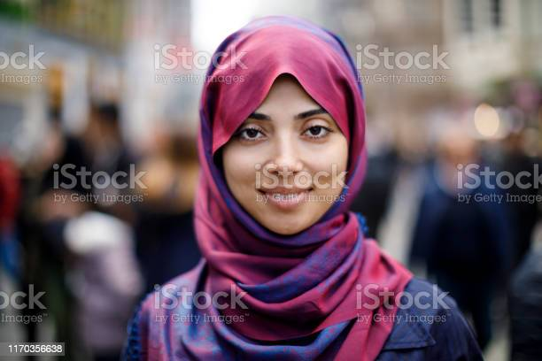 Portrait Of Smiling Muslim Woman Outdoors Stock Photo - Download Image Now