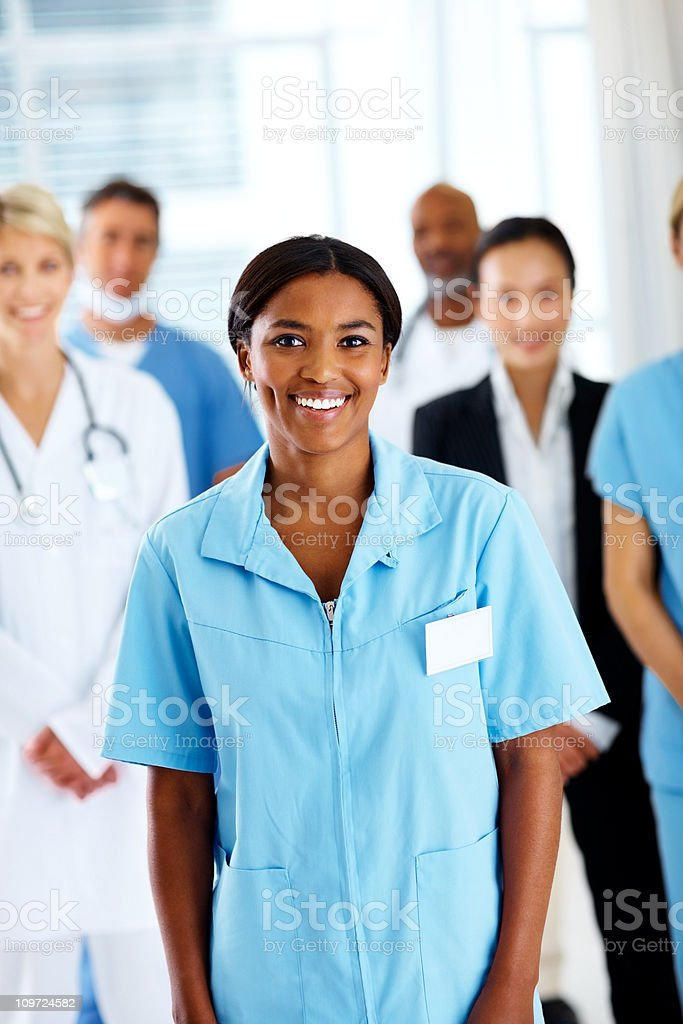 Portrait of smiling nurse with healthcare professionals royalty-free stock photo