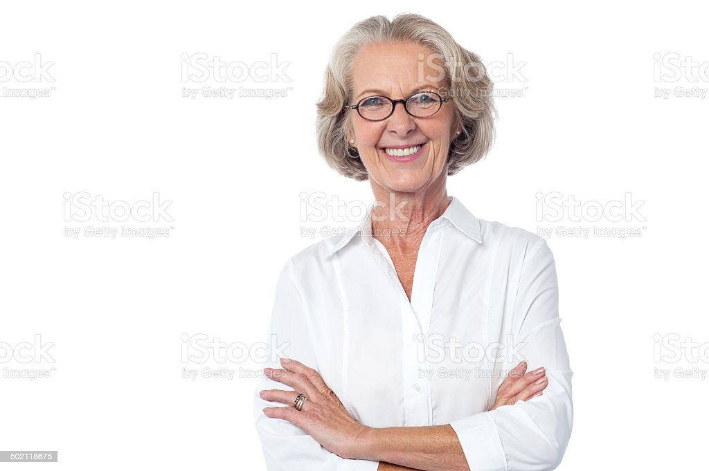 Portrait of smiling old lady, arms crossed. - Royalty-free Adult Stock Photo