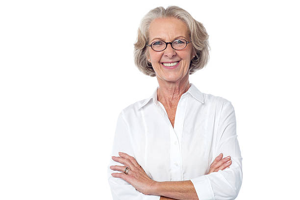 Portrait of smiling old lady, arms crossed. stock photo