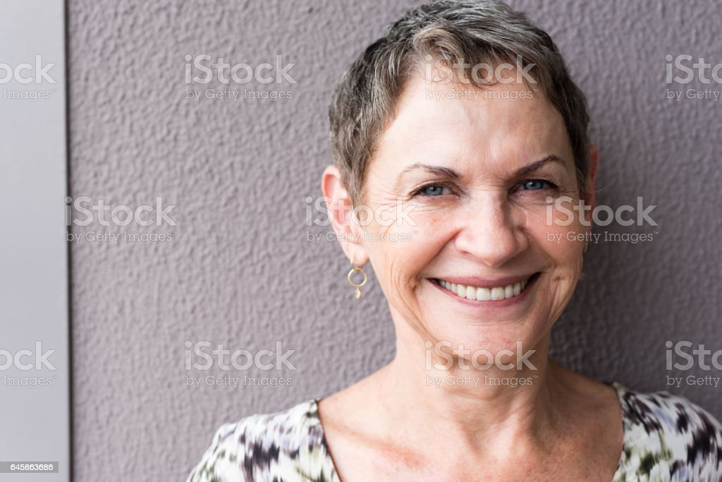 Portrait of smiling older woman stock photo