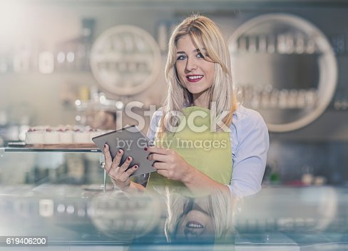 1066358064 istock photo portrait of smiling owner standing in her coffee shop 619406200