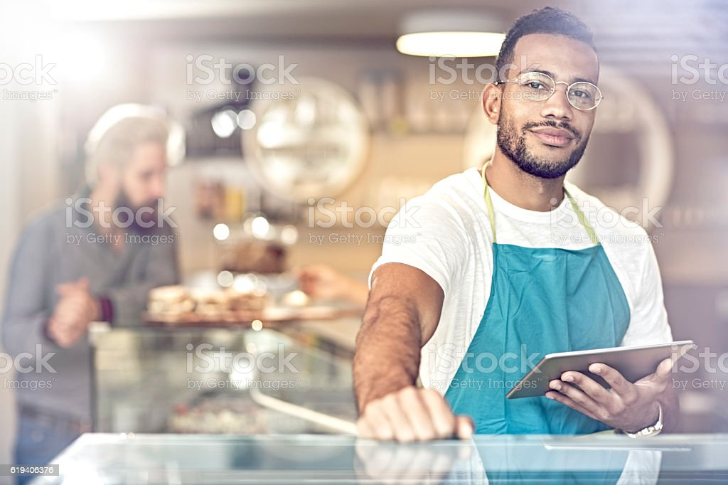 portrait of smiling owner standing in her coffee shop stock photo