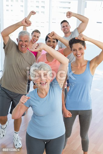 istock Portrait of smiling people doing power fitness exercise 693103824
