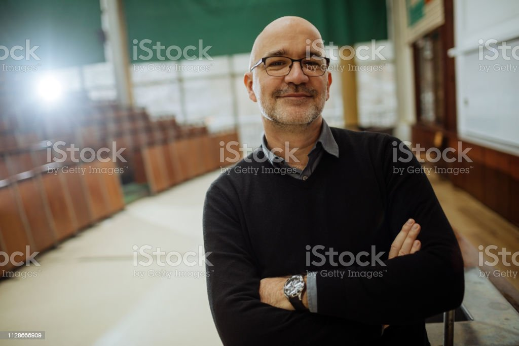 Portrait of smiling professor in the amphitheater stock photo