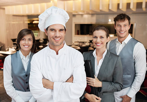 Portrait of smiling restaurant employees  chef's whites stock pictures, royalty-free photos & images