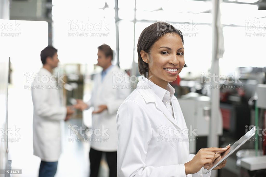 Portrait of smiling scientist in libraries stock photo