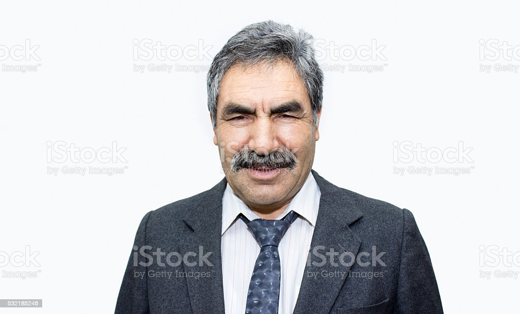 Portrait of smiling senior businessman over white background stock photo