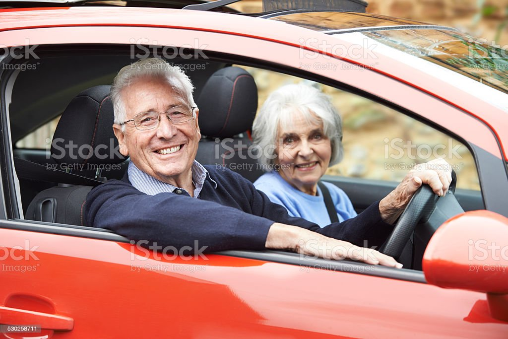 Portrait Of Smiling Senior Couple Out For Drive In Car stock photo