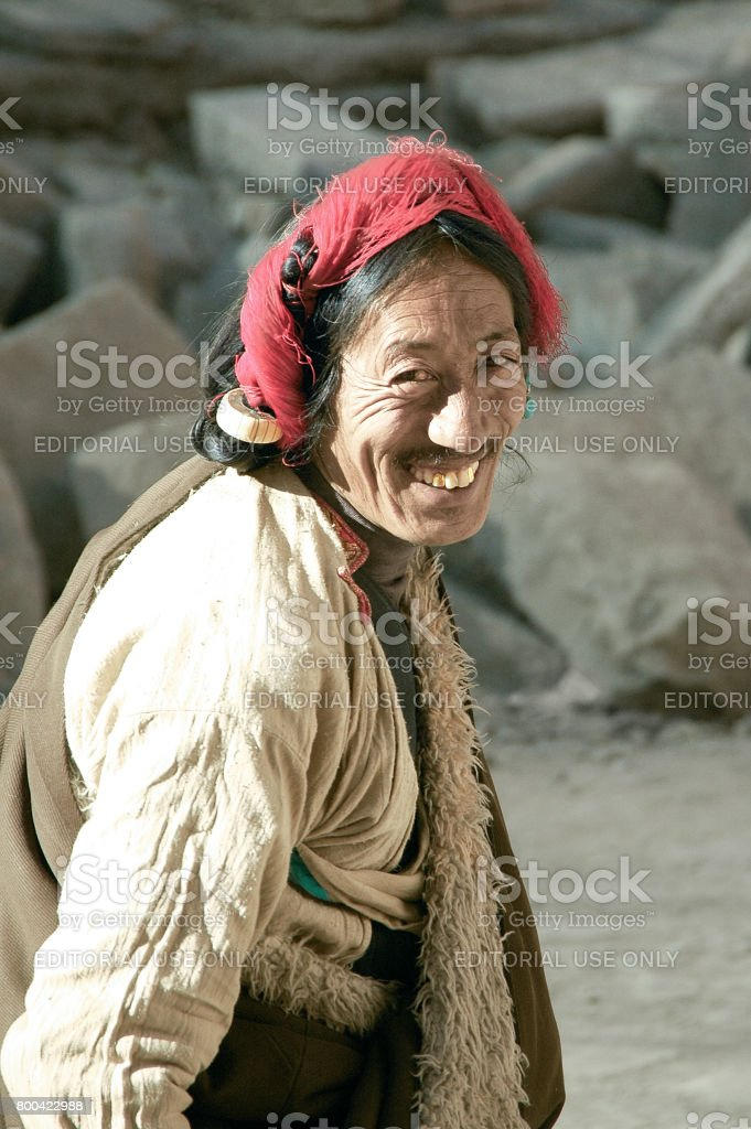 Portrait of Smiling Senior Khampa Man Wearing Tradition Hair Accessories stock photo