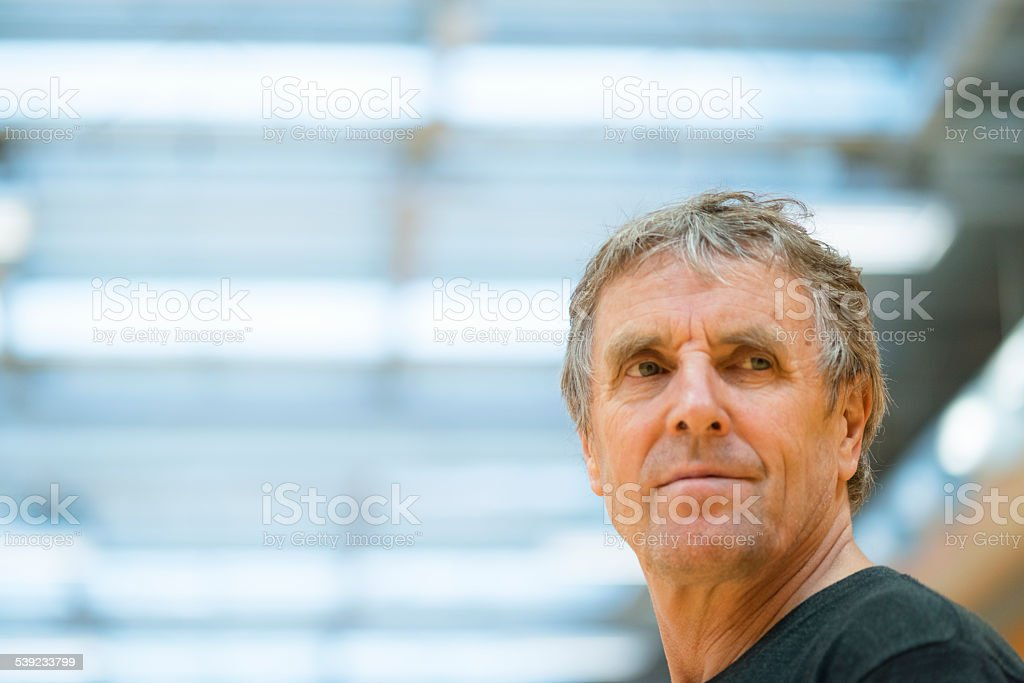 Portrait of Smiling Senior Man, School Gymnasium, Europe royalty-free stock photo