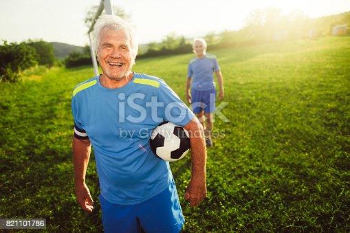 istock Portrait of smiling, senior soccer player 821101786