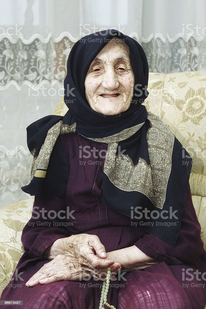 Portrait of smiling senior with beads royalty-free stock photo