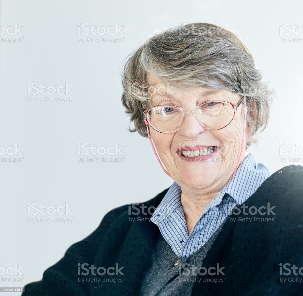 Portrait of smiling senior woman in spectacles royalty-free stock photo