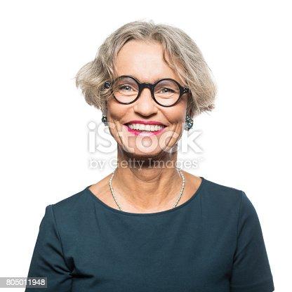 Portrait of smiling senior woman with eyeglasses isolated on white background