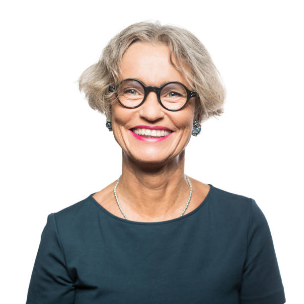 Portrait of smiling senior woman with eyeglasses stock photo