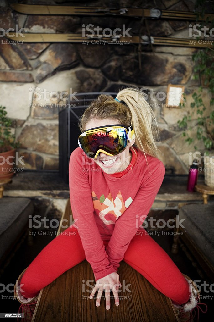 Portrait of smiling skier girl in lodge. royalty-free stock photo