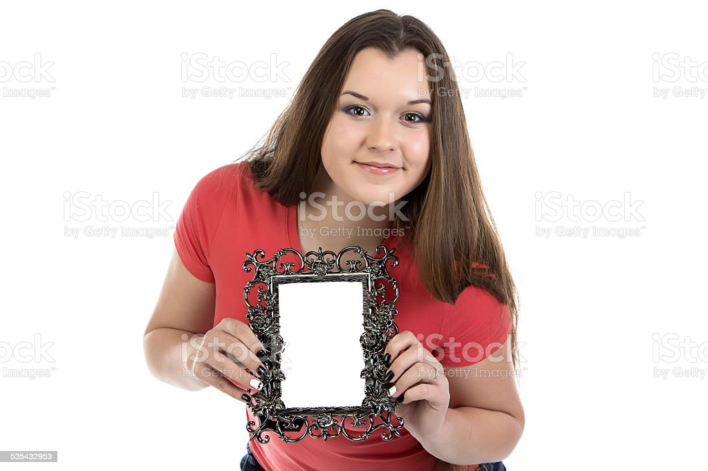Portrait of smiling teenage girl with photo frame stock photo