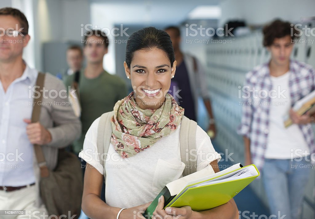 Portrait of smiling university student in corridor royalty-free stock photo