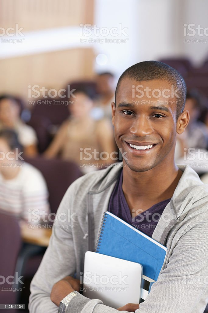 Portrait of smiling university student in lecture hall royalty-free stock photo