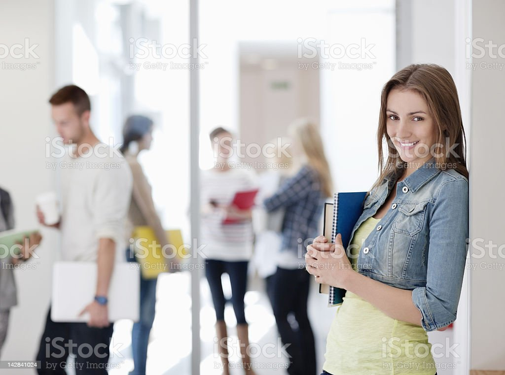 Portrait of smiling university student with books royalty-free stock photo