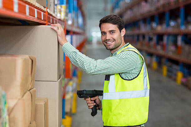Warehouse worker pictures images and stock photos istock portrait of smiling warehouse worker scanning box stock photo sciox Choice Image