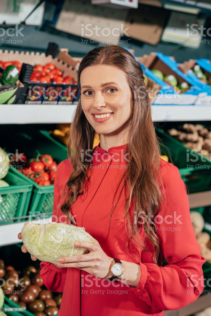 Portrait Of Smiling Woman Choosing Fresh Raw Vegetables In