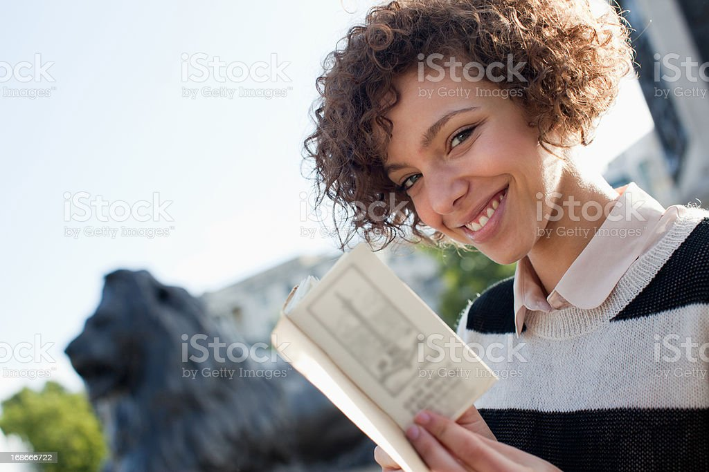 Portrait of smiling woman holding book royalty-free stock photo