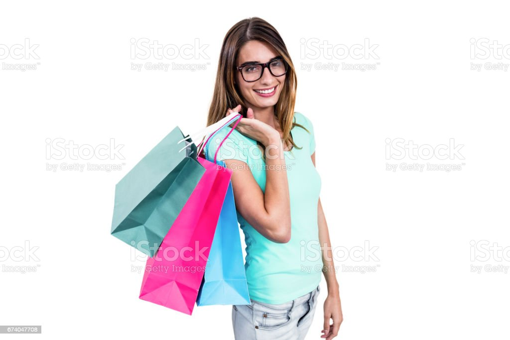 Portrait of smiling woman holding shopping bags royalty-free stock photo