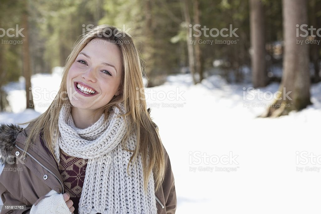 Portrait of smiling woman in snowy woods royalty-free stock photo