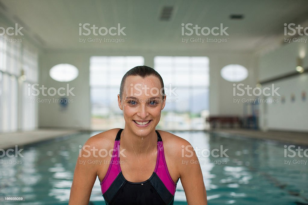 Portrait of smiling woman in swimming pool royalty-free stock photo