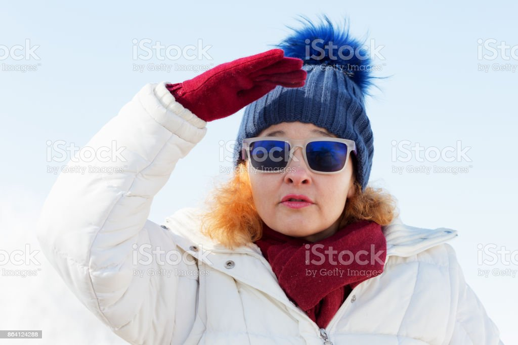 Portrait of smiling woman in winter royalty-free stock photo