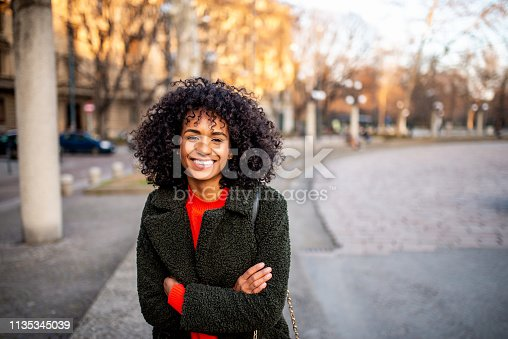 Beautiful smiling Brazilian woman looking at camera