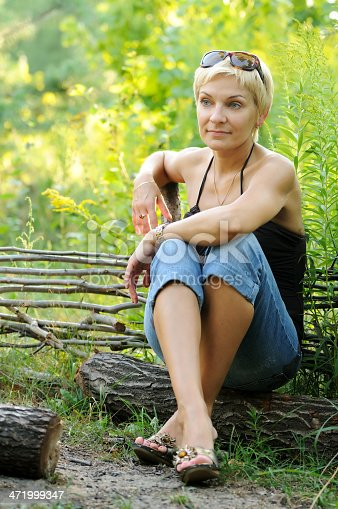 977601820 istock photo portrait of smiling woman outdoors 471999347