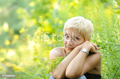 977601820 istock photo portrait of smiling woman outdoors 471999493