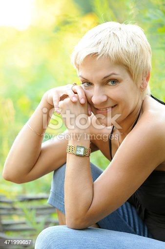 977601820 istock photo portrait of smiling woman outdoors 471999657