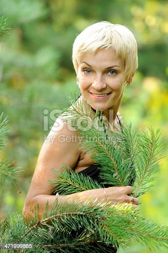 977601820 istock photo portrait of smiling woman outdoors 471999865