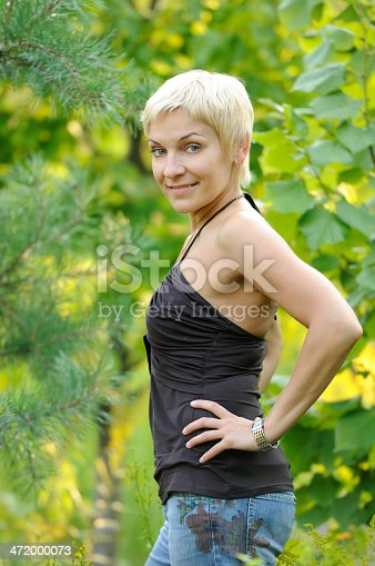 977601820 istock photo portrait of smiling woman outdoors 472000073