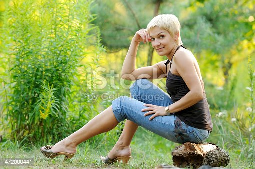 977601820 istock photo portrait of smiling woman outdoors 472000441