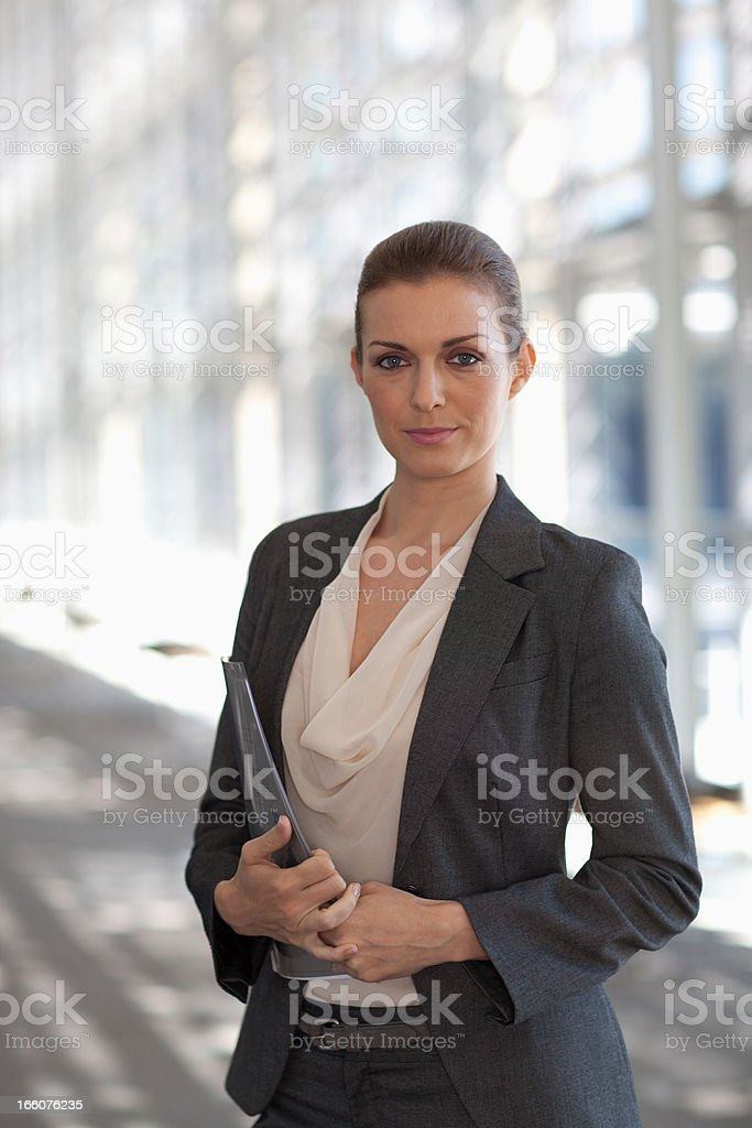 Portrait of smiling woman standing in corridor royalty-free stock photo