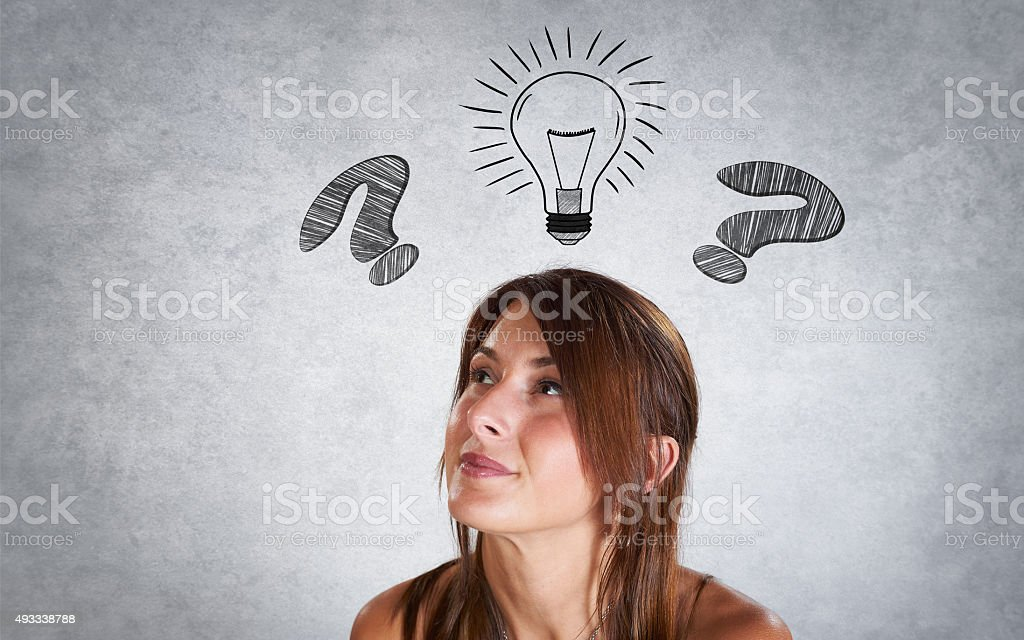 Portrait of smiling woman thinking with interogation point and b stock photo