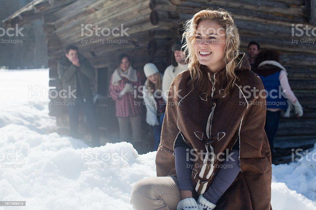 Portrait of smiling woman with friends in background royalty-free stock photo
