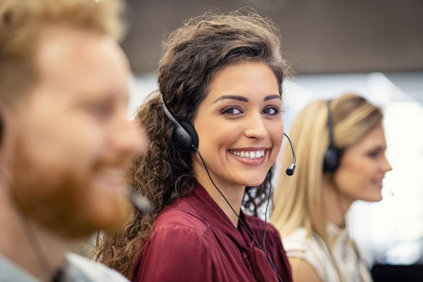 Portrait of smiling woman working in call center stock photo