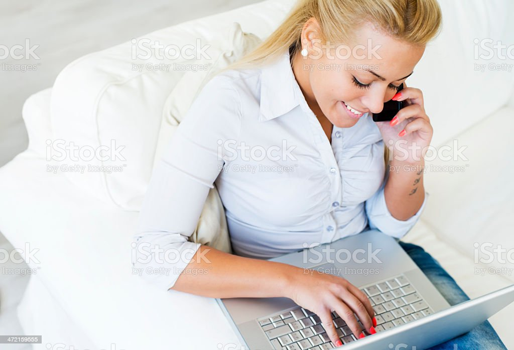 Portrait of smiling  woman working on laptop at home royalty-free stock photo