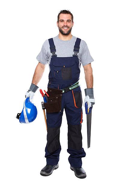 porträt eines lächelnden arbeiter in blauer uniform - legere arbeitskleidung stock-fotos und bilder