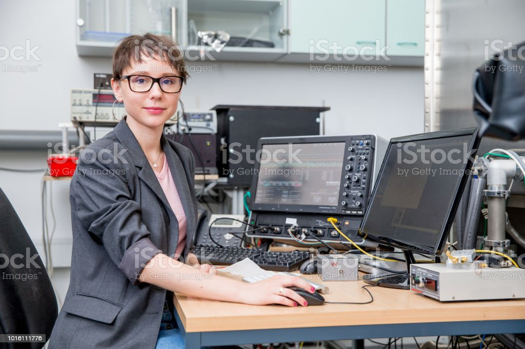 Portrait of Smiling Young Adult Female Researcher in Laboratory stock photo